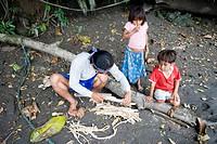 Preparing the barbasco root to go fishing, Amazon, Ecuador, South America