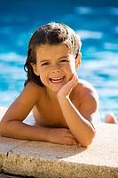 Little caucasian girl in the swimming pool