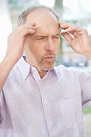 Man suffering from a headache