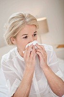 Close_up of a woman suffering from cold
