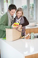 Couple checking groceries at home