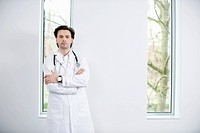 Portrait of a doctor standing with his arms crossed