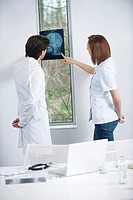Two doctors examining an x_ray