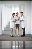 Three doctors discussing a medical report