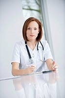 Female doctor working in an office