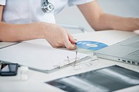 Female doctor inserting CD into a laptop