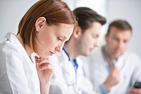 Female doctor working with her colleagues