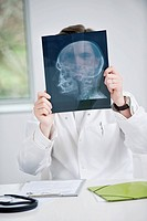 Male doctor examining an x_ray