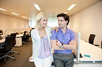 Business couple smiling in an office