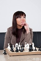 Business women playing chess