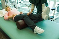 Woman being treated by physical therapist