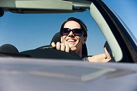 Woman enjoying drive on sunny day