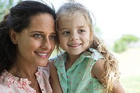 Mother and daughter together outdoors, portrait (thumbnail)