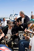 Stromness Folk Festival STROMNESS ORKNEY Musicians group playing banjo violins and guitars instruments