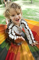Little boy having fun outdoors, portrait