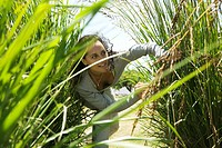 Woman hiding in tall grass