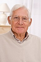 Portrait of smiling senior man with glasses