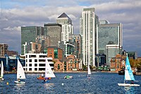 England, London, Docklands, Sailing in Millwall docks infront of Canary Wharf