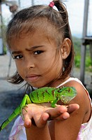 Young native Honduran girl with chameleon Isla Roatan Honduras Central America