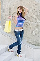 Shopping girl walking downstairs