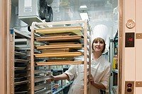 Female chef in walk in freezer in commercial kitchen