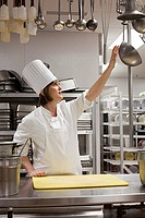 Female chef working in commercial kitchen