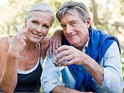 Mature couple outdoors with wine (thumbnail)