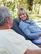 Mature couple on loungers in garden