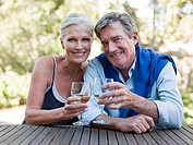 Mature couple outdoors with wine