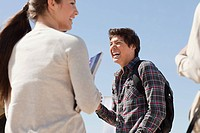 High school students talking and laughing outside (thumbnail)