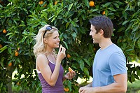 Couple by orange tree