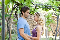 Happy couple in a vineyard