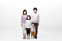 Parents and two children all wearing surgical masks