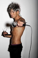 young man with silver hair holding silver hair dryer and scissors