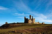 England, Northumberland, Dunstanburgh Castle. The remains of Dunstanburgh Castle, the largest castle in Northumberland, built in the 14th century.