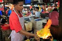 Malaysia, Kuala Lumpur, Kampung Baru, cook grilling chicken,