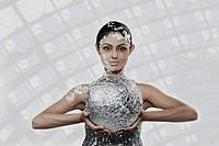Woman holding a foil globe