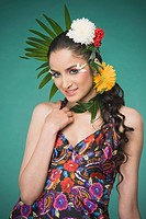 Woman wearing flowers and posing