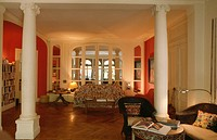 Parquet floor in living room with classical pillars
