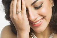 Close_up of a woman wearing jewelry and smiling