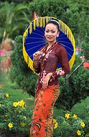 A Malaysian girl dressed in traditional costumes with colorful umbrella