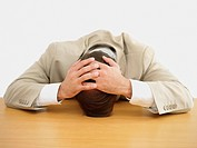 Businessman leaning with his head on the table