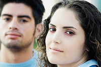 Portrait of a young couple looking serious