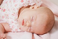 Close_up of a baby girl sleeping