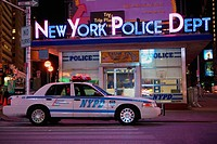 Car in front of a police station, New York City, New York State, USA