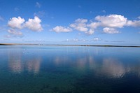 Kettletoft Bay SANDAY ORKNEY Sea water sky farms reflecting clouds peaceful sunny day Els Ness