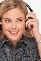 Pretty blond woman wearing headphones
