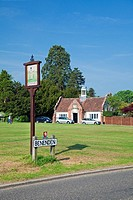 England Kent Benenden Village Sign with distant Village Hall and The Green
