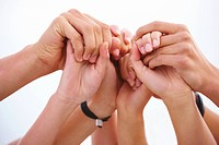 Closeup of human hands joined together Symbol of strength or teamwork