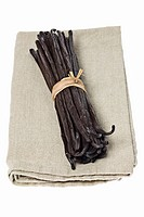 A bundle of vanilla pods on linen cloth